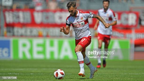 Maximilian Zimmer of Cottbus runs with the ball during the 3. Liga match between FC Energie Cottbus and F.C. Hansa Rostock at Stadion der...