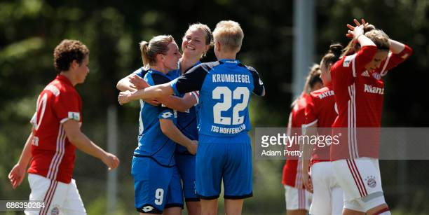 Maximiliane Rall congratulates Annika Eberhardt of Hoffenheim II after she scored a goal during the match between 1899 Hoffenheim II and FCB Muenchen...