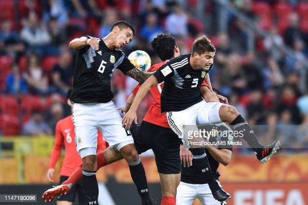 Maximiliano Centurio of Argentina and Santiago Sosa of Argentina compete with Sehun Oh of Korea Republic during the FIFA U20 World Cup match between...