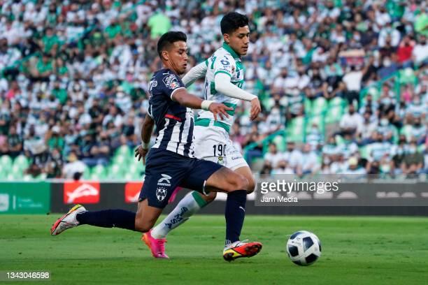 Maximiliano Eduardo Meza of Monterrey fights for the ball with Omar Campos of Santos during the 10th round match between Santos Laguna and Monterey...