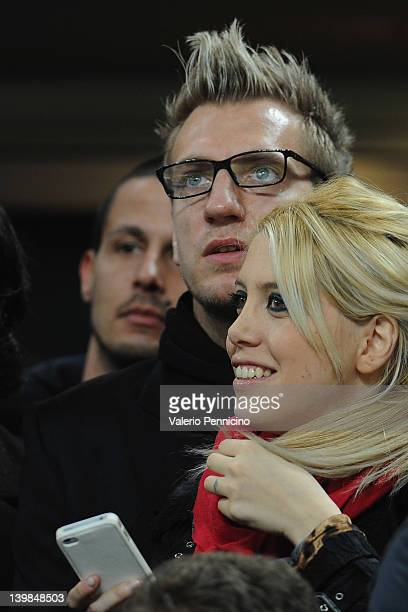 Maximiliano Gaston Lopez and wife Wanda Nara attend the Serie A match between AC Milan and Juventus FC at Stadio Giuseppe Meazza on February 25 2012...