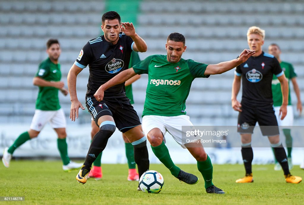 Maximiliano Gomez (L) of Celta de Vigo competes for the ball with Victor Vazquez of Racing de Ferrol during the pre-season friendly match between Celta de Vigo and Racing de Ferrol at A Malata Stadium on July 22, 2017 in Ferrol, Spain.