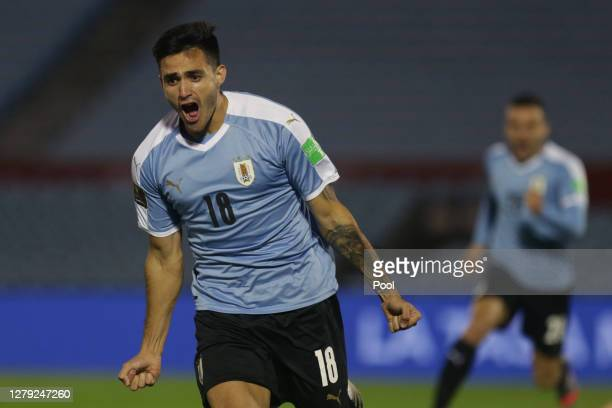 Maximiliano Gomez of Uruguay celebrates after scoring the second goal of his team during a match between Uruguay and Chile as part of South American...