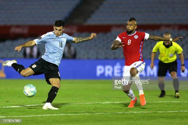 Maximiliano Gomez of Uruguay kicks the ball to score the second goal of his team during a match between Uruguay and Chile as part of South American...