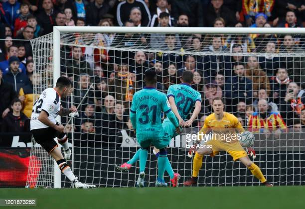 Maximiliano Gomez of Valencia scores his team's second goal during the La Liga match between Valencia CF and FC Barcelona at Estadio Mestalla on...