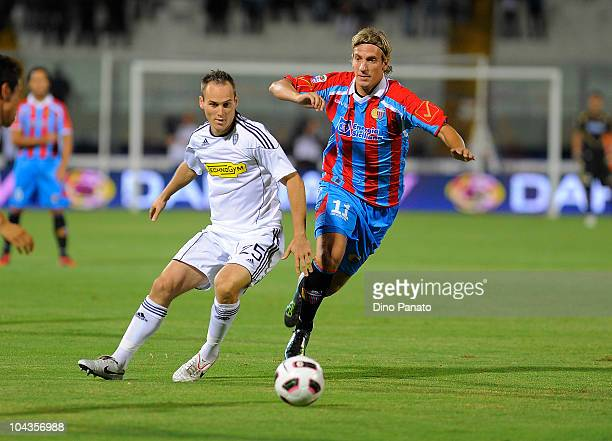 Maximiliano Lopez of Catania in action with Steve Von Bergen of Cesena during the Serie A match between Catania and Cesena at Stadio Angelo Massimino...