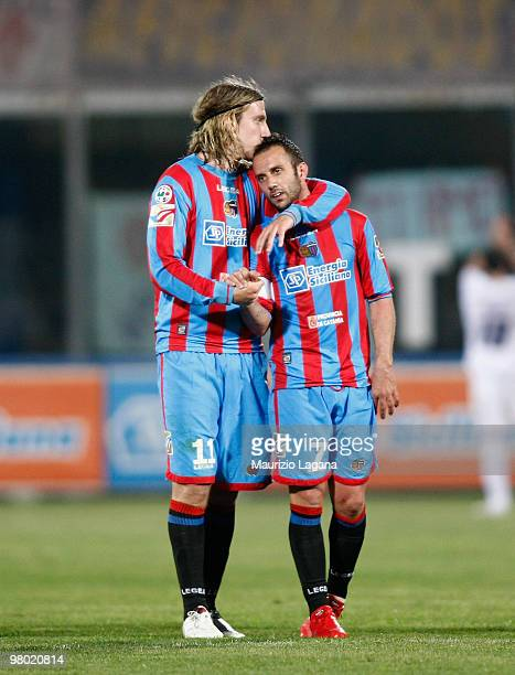 Maximiliano Maxi Lopez and Giuseppe Mascara of Catania Calcio celebrate during the Serie A match between Catania Calcio and ACF Fiorentina at Stadio...