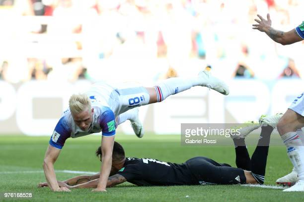 Maximiliano Meza of Argentina and Hordur Magnusson of Iceland clash leading to a penalty awarded to Argentina during the 2018 FIFA World Cup Russia...