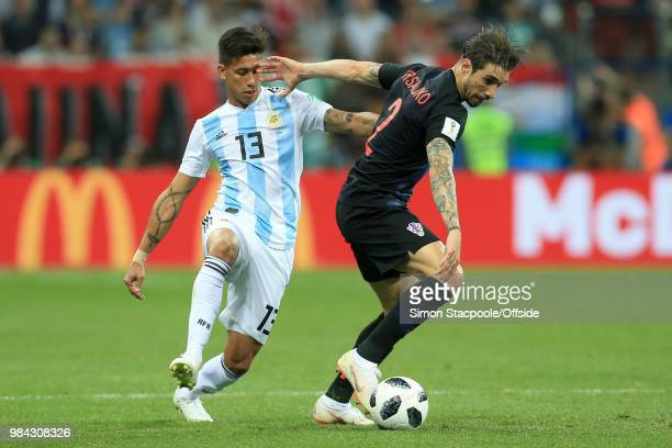 Maximiliano Meza of Argentina battles with Sime Vrsaljko of Croatia during the 2018 FIFA World Cup Russia Group D match between Argentina and Croatia...