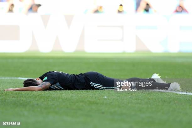 Maximiliano Meza of Argentina goes down leading to a penalty awarded to Argentina during the 2018 FIFA World Cup Russia group D match between...