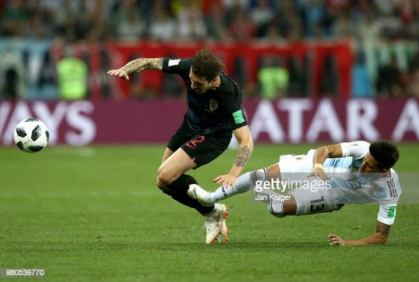 Maximiliano Meza of Argentina tackles Sime Vrsaljko of Croatia during the 2018 FIFA World Cup Russia group D match between Argentina and Croatia at...