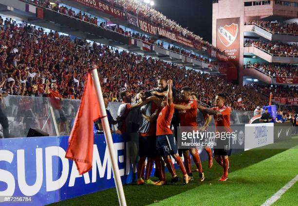 Maximiliano Meza of Indendiente celebrates with teammates after scoring the second goal of his team during the first leg of the Copa Sudamericana...