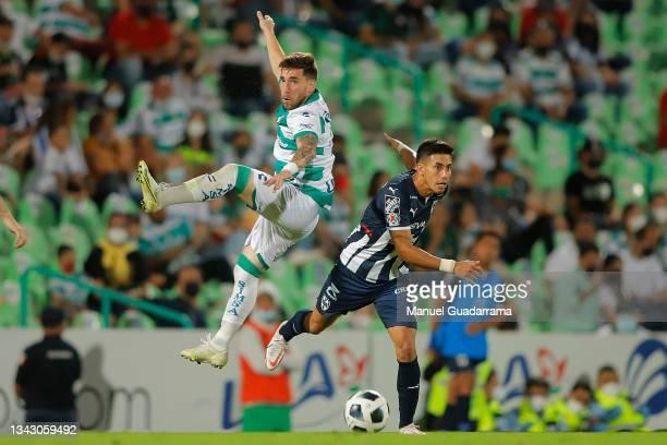 Maximiliano Meza of Monterrey struggles for the ball with Fernando Gorriaran of Santos during the 10th round match between Santos Laguna and Monterey...