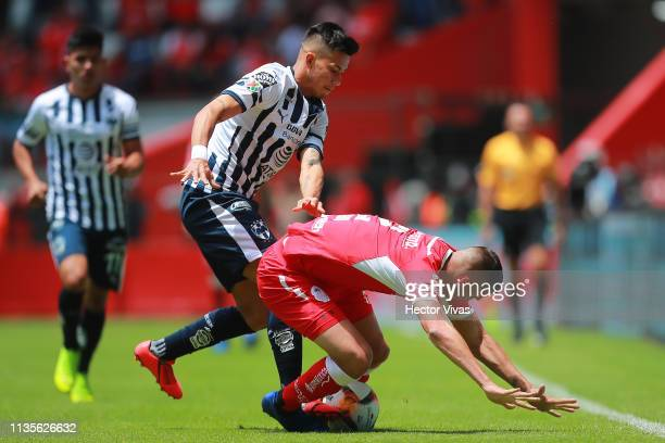 Maximiliano Meza of Monterrey struggles for the ball with Omar Tobio of Toluca during the 13th round match between Toluca and Monterrey as part of...
