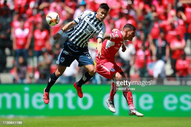 Maximiliano Meza of Monterrey struggles for the ball with Richard Ruiz of Toluca during the 13th round match between Toluca and Monterrey as part of...