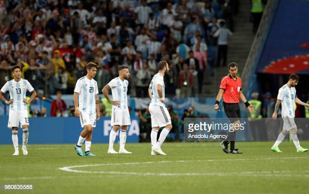 Maximiliano Meza Paulo Dybala Nicolas Otamendi Gonzalo Higuain and Lionel Messi of Argentina gesture after losing the 2018 FIFA World Cup Russia...