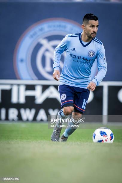Maximiliano Moralez of New York City eyes the opening across the pitch with the NYCFC Logo behind him during the Major League Soccer match between...