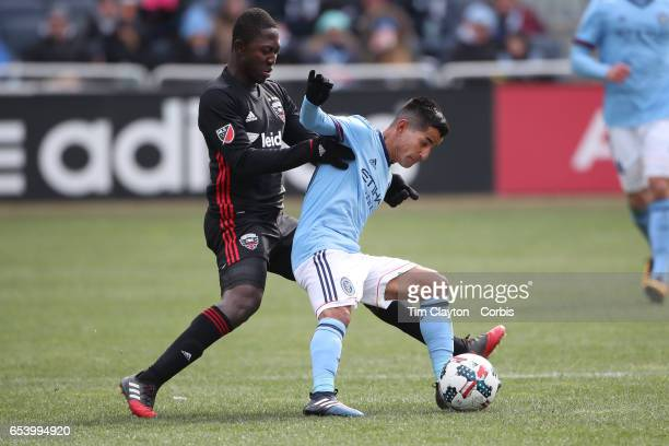 Maximiliano Moralez of New York City FC is challenged by Patrick Nyarko of DC United during the NYCFC Vs DC United regular season MLS game at Yankee...