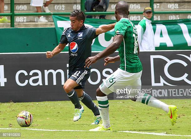 Maximiliano Nuñez of Millonarios and German Mera of Cali fight for the ball during a match between Deportivo Cali and Millonarios as part of round 13...