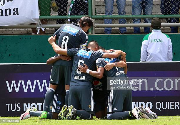 Maximiliano Nuñez of Millonarios celebrates with teammates after scoring the opening goal during a match between Deportivo Cali and Millonarios as...