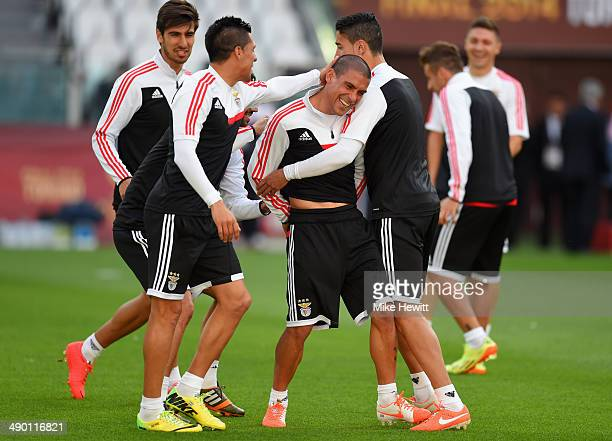 Maximiliano Pereira of Benfica shares a joke with tea mates during an SL Benfica training session ahead of the UEFA Europa League Final against...