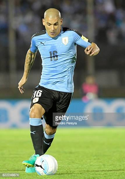Maximiliano Pereira of Uruguay drives the ball during a match between Uruguay and Ecuador as part of FIFA 2018 World Cup Qualifiers at Centenario...
