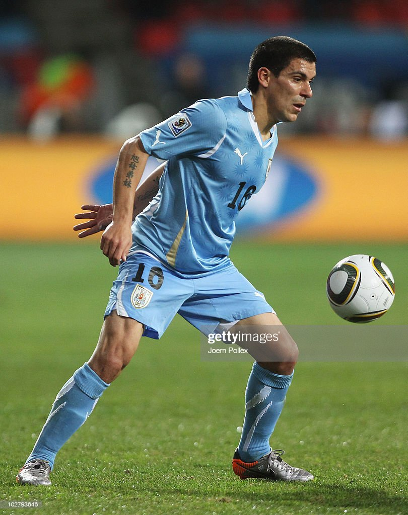 Maximiliano Pereira of Uruguay in action during the 2010 FIFA World Cup South Africa Third Place Play-off match between Uruguay and Germany at The Nelson Mandela Bay Stadium on July 10, 2010 in Port Elizabeth, South Africa.
