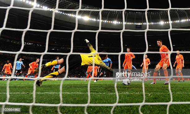 Maximiliano Pereira of Uruguay scores past Maarten Stekelenburg of the Netherlands during the 2010 FIFA World Cup South Africa Semi Final match...