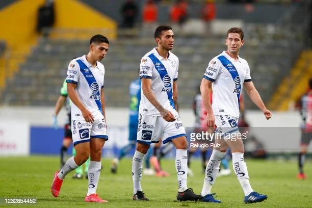 Maximiliano Perg of Puebla reacts with teammates during the quarterfinals first leg match between Atlas and Puebla as part of the Torneo Guard1anes...