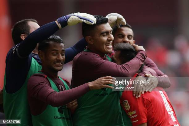 Maximiliano Perg of Toluca celebrates with teammates after scoring the first goal of his team during the seventh round match between Toluca and...