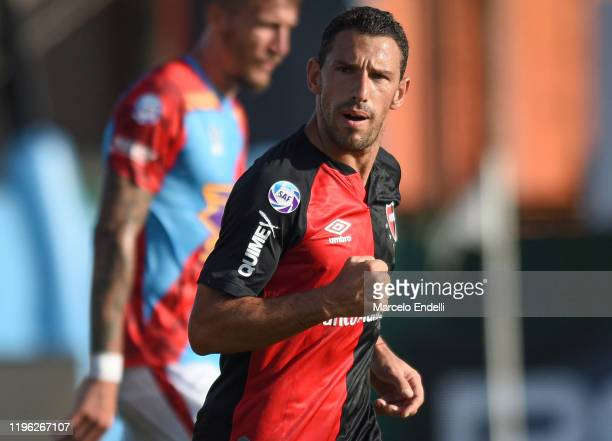 Maximiliano Rodriguez of Newells celebrates after scoring the first goal of his team during a match between Arsenal and Newell's Old Boys as part of...