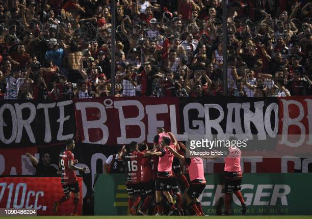 Maximiliano Rodriguez of Newell´s celebrates with teammates after scoring the first goal of his team during a match between Newell s Old Boys and...