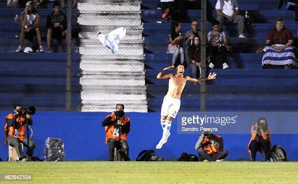 Maximiliano Rolón of Argentina celebrates after scoring his team's first goal during a match between Argentina and Brazil as part of South American...