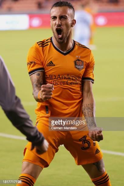 Maximiliano Urruti of Houston Dynamo celebrates his goal in the 56th minute against the Sporting Kansas City at BBVA Stadium on May 12, 2021 in...