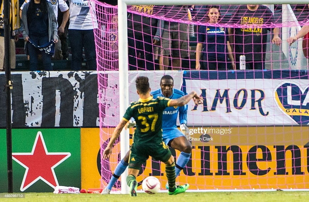 Maximiliano Urruti #37 of Portland Timbers scores a goal as Donovan Ricketts #1 of Los Angeles Galaxy looks on during Los Angeles Galaxy's MLS match against Portland Timbers at the StubHub Center on October 18, 2015 in Carson, California. The Portland Timbers won the match 5-2