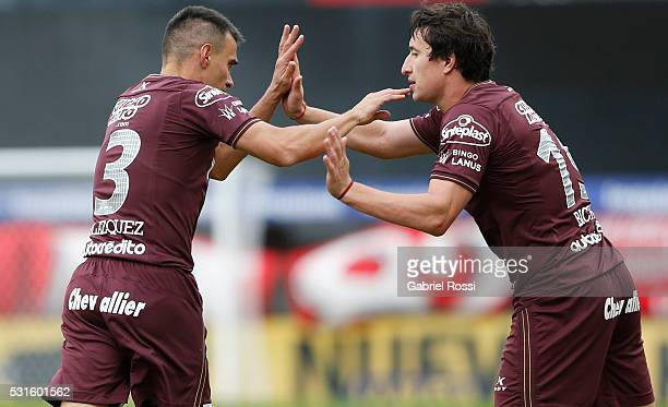 Maximiliano Vela‡zquez of Lanus celebrates with teammate Nicolas Aguirre after scoring the opening goal during a match between Argentinos Juniors and...
