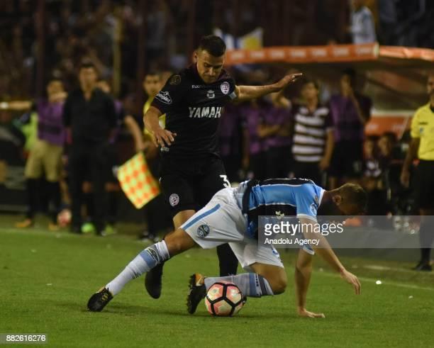 Maximiliano Velazquez of Lanus fights for the ball with Luan Guilherme de Jesus Vieira of Gremio during Copa Libertadores final match between Lanus...