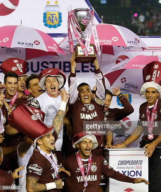 Maximiliano Velazquez of Lanus lifts the trophy after a final match between San Lorenzo and Lanus as part of Torneo Transicion 2016 at Monumental...
