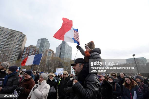 Maximilien Caruso-Kraweis, 3 sits on his fathers shoulders, Nicolas Kraweis to show support for their native home, Paris. In the wake of deadly...