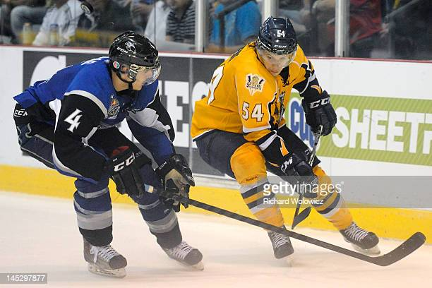 Maximilien Le Sieur of the Shawinigan Cataractes and Ian Saab of the Saint John Sea Dogs chase the puck into the corner during the 2012 MasterCard...