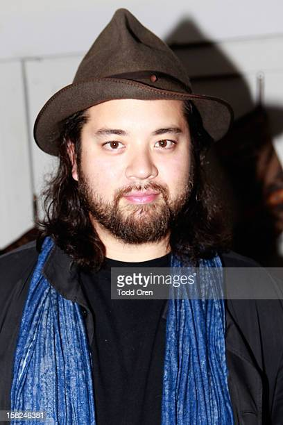 Maximillian Chow poses at the I Heart Ronson Holiday Party at The Bungalow on December 11 2012 in Santa Monica California