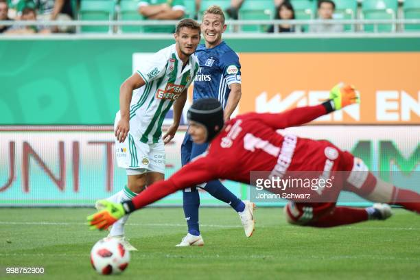 Maximillian Hofmann of Rapid Lewis Holtby of Hamburger SV and Richard Strebinger of Rapid during the Pre Season Friendly match between SK Rapid and...