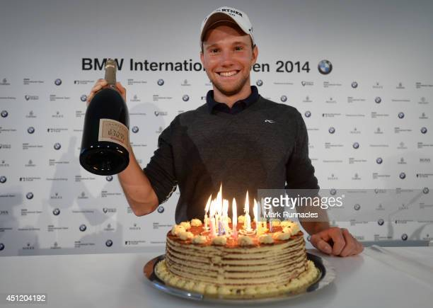 Maximillian Kieffer of Germany celebrates his 24th birthday after receiving a gift from sponsor BMW during the BMW International Open ProAm day at...