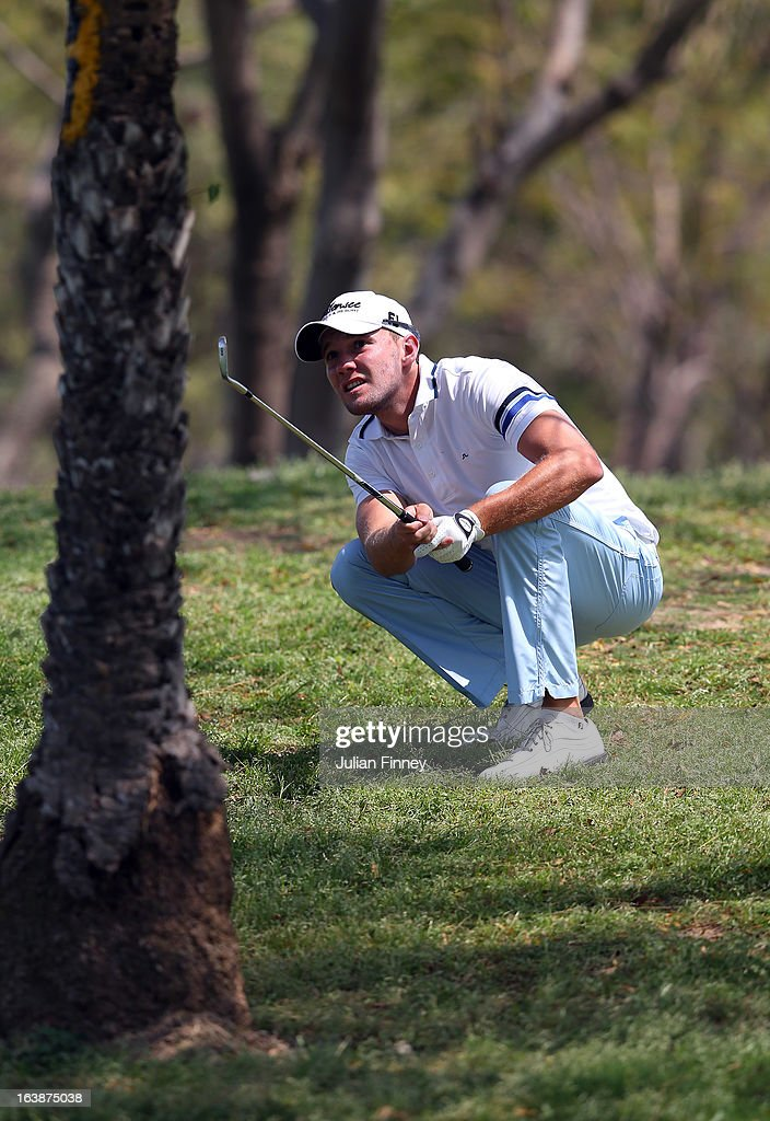 Maximillian Kieffer of Germany watches his shot through the trees during day four of the Avantha Masters at Jaypee Greens Golf Club on March 17, 2013 in Delhi, India.
