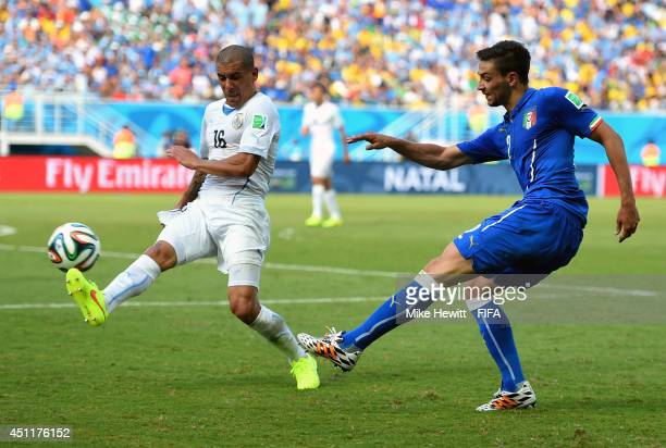 Maximilliano Pereira of Uruguay attempts to block Mattia De Sciglio of Italy during the 2014 FIFA World Cup Brazil Group D match between Italy and...
