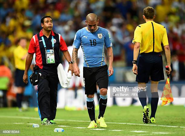 Maximilliano Pereira of Uruguay leaves the pitch after being sent off during the 2014 FIFA World Cup Brazil Group D match between Uruguay and Costa...