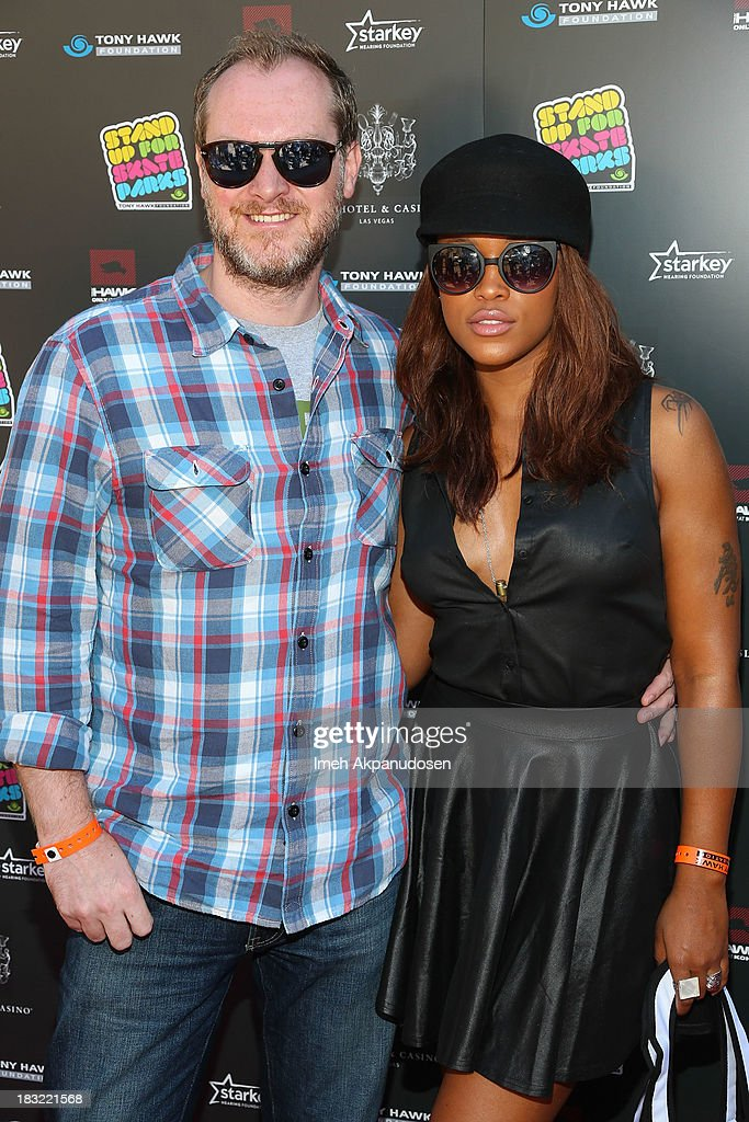 Maximillion Cooper (L) and rapper Eve attend the 10th Annual Stand Up For Skateparks Benefiting The Tony Hawk Foundation on October 5, 2013 in Beverly Hills, California.