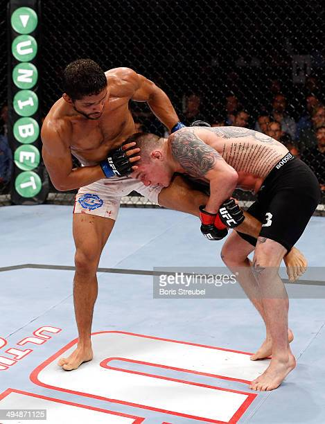 Maximo Blanco fights Andy Ogle during the Maximo Blanco vs. Andy Ogle preliminary match of the Mark Munoz vs. Gegard Mousasi Ultimate Fighting...