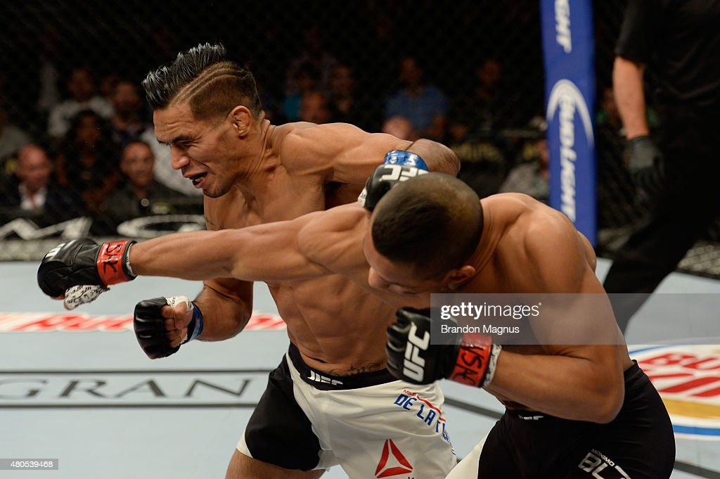 Maximo Blanco punches Mike De La Torre in their featherweight bout during the Ultimate Fighter Finale inside MGM Grand Garden Arena on July 12, 2015 in Las Vegas, Nevada.