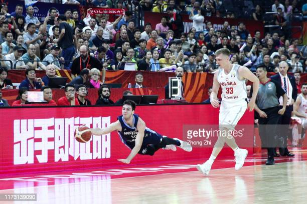 Maximo Fjellerup of the Argentina National Team in action against Karol Gruszecki of the Poland National Team during the 2nd round of 2019 FIBA World...